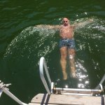 My friend James swimming of hotel boat with hot springs underneath him.