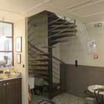 Spiral staircase down into the breakfast room