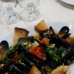 Lovely sauteed mussels with risotto alla pescatora in the background