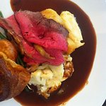 Roast sirloin of beef, yorkshire pudding, roast potatoes, swede puree and horseradish cream.