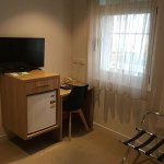 Small refrigerator, flat-screen TB, desk/chair