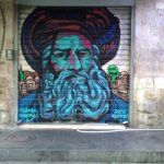An art at night.. shutters painted at Mahane Yehuda by an artist from London.