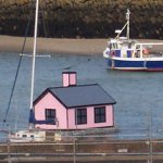 A little pink house floating in the harbour
