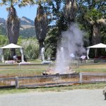 More of the geyser spitting with some of the seating in the background