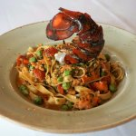Lobster Fettucine with in-house made lobster sauce, fresh hand rolled pasta & juicy summer peas.