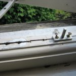 Bodged repairs to the window frame, seems typical of maintenance