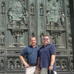 Us standing in front of the doors of the Duomo