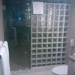 Huge bathroom and shower with two shower heads and a rain shower