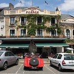 Photo of the Hotel de France with a red 1938 Aston Martin 15/98