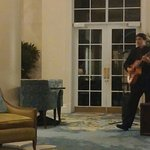Spanish acoustic guitarist in lobby