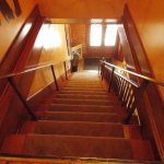 Higher stair rail inside of original rail.