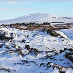 And hidden within the vast whiteness, a frozen crater… @ Kerið volcanic crater