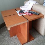 Damaged side table in room 701