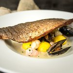 Pan fried seabass fillet Served with saffron noisette potatoes, fish stew and a chive cream sauc
