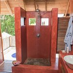 open air bathroom with ceiling fan