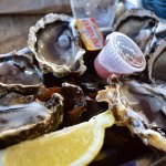 Fresh oysters with mignonette sauce.