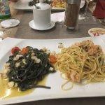 Spaghetti neri con filetti di branzino, pomodorini e basilico (left)