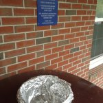 "At the front door: foil-ashtray below the ""NO SMOKING"" sign"