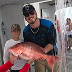 Huge snapper a crew member got on the line then immediately handed to my nephew to reel in.