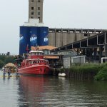 Sailing by Riverworks and the oldest active fire boat in the US, the Edward M Cotter.