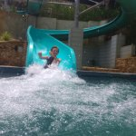 Son hitting the water slide