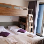 Bunk bed restricts air movement and makes it feel even warmer sleeping there
