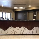 Reception area with new mountain/trees artwork. Lake view through the windows on left..