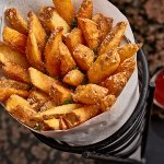 Kennebec fries served with house-made heirloom tomato ketchup