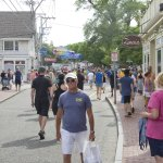 Visitors throng Commercial Street even on a weekday during July.