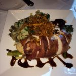 Prosciutto wrapped chicken breast with balsamic glaze.