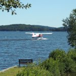 Float plane departing on the lake in front of the motel