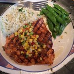 Salmon with sugar snap peas and rice pilaf