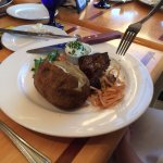 petit beef filet with sugar snap peas, and baked potato