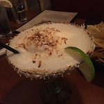 Coconut margarita with toasted coconut topping and around the glass rim! YUM!!