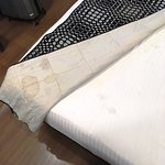 Old stained bed linen