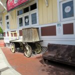 railway artifacts - baggage cart and bench