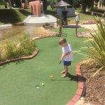 Our grandchild playing minigolf