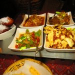 Meat and vegetable dishes and banana fritters for dessert