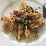 Sausage ravioli, with sage butter and bacon dressing.