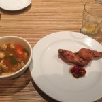 Tom Yum soup and one of the chicken wings