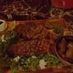 Huge T-Bone Angus Steak with Potatoes and Arugula Greens