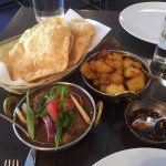 Puris, Nepalese potatoes, goat curry and cut chilli paste