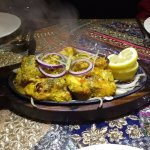 fish tikka in sizzling plate
