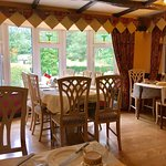 Taken at Arch House during a recent stay. Dining room, rabbits, hydrangea flowers and wooded dri