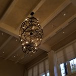 A grand lobby with high ceilings and elegant decorations