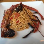 Lobster cooked in its own juices with linguine and tomatoes, it was sweet and delicious