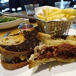 Pastrami sandwich w/fries looked a little weird, but tasted great. Photobombed by the Caesar Sal