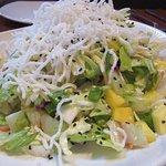 Mandarin crunch salad piled high with crispy rice sticks.