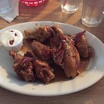 One of Paulette's many flavors of chicken wings, Bourbon Bacon Wings!