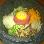 Raw beef with egg and vegetable stone rice